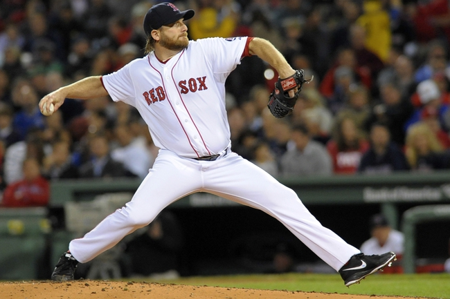 Sep 17, 2013; Boston, MA, USA; Boston Red Sox starting pitcher Ryan Dempster (46) pitches during the third inning against the Baltimore Orioles at Fenway Park. Mandatory Credit: Bob DeChiara-USA TODAY Sports