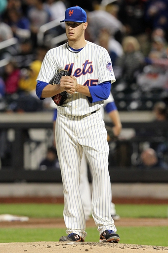 Sep 17, 2013; New York, NY, USA; New York Mets starting pitcher Zack Wheeler (45) reacts after allowing three runs to the San Francisco Giants during the second inning of a game at Citi Field. Mandatory Credit: Brad Penner-USA TODAY Sports