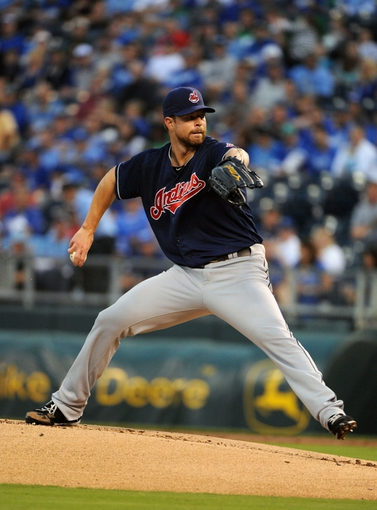 Sep 17, 2013; Kansas City, MO, USA; Cleveland Indians starting pitcher Corey Kluber (28) delivers a pitch in the first inning against the Kansas City Royals at Kauffman Stadium. Mandatory Credit: John Rieger-USA TODAY Sports