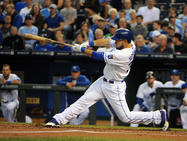 Sep 17, 2013; Kansas City, MO, USA; Kansas City Royals first baseman Eric Hosmer (35) drives in a run with a double in the first inning against the Cleveland Indians at Kauffman Stadium. Mandatory Credit: John Rieger-USA TODAY Sports