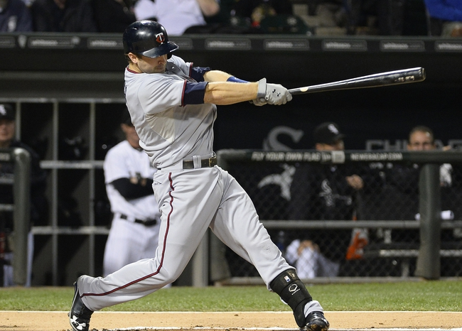 Sep 17, 2013; Chicago, IL, USA; Minnesota Twins second baseman Brian Dozier (2) hits a single against the Chicago White Sox during the first inning at U.S Cellular Field. Mandatory Credit: Mike DiNovo-USA TODAY Sports