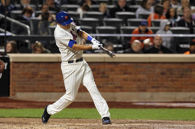 Sep 17, 2013; New York, NY, USA; New York Mets third baseman Wilmer Flores (4) hits an RBI double against the San Francisco Giants during the fourth inning of a game at Citi Field. Mandatory Credit: Brad Penner-USA TODAY Sports