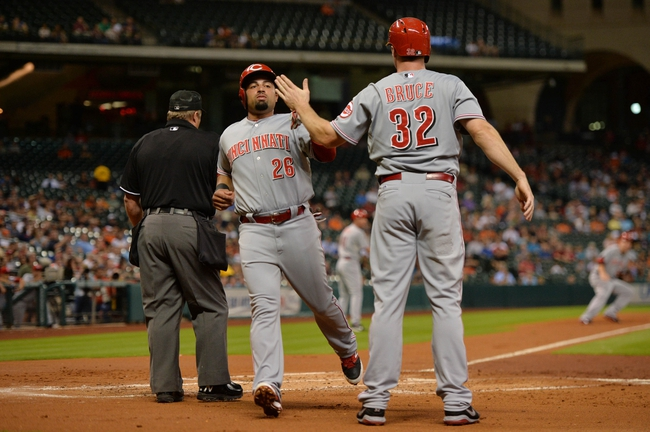 Sep 17, 2013; Houston, TX, USA; Cincinnati Reds left fielder Xavier Paul (26) and right fielder Jay Bruce (32) celebrate after scoring a run against the Houston Astros during the first inning at Minute Maid Park. Mandatory Credit: Thomas Campbell-USA TODAY Sports