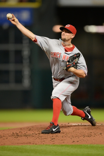 Sep 17, 2013; Houston, TX, USA; Cincinnati Reds starting pitcher Mike Leake (44) throws the ball against the Houston Astros during the first inning at Minute Maid Park. Mandatory Credit: Thomas Campbell-USA TODAY Sports