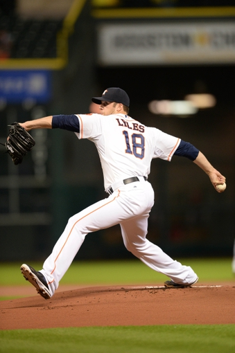 Sep 17, 2013; Houston, TX, USA; Houston Astros starting pitcher Jordan Lyles (18) throws the ball against the Cincinnati Reds during the first inning at Minute Maid Park. Mandatory Credit: Thomas Campbell-USA TODAY Sports