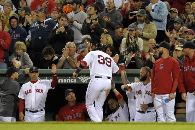 Sep 17, 2013; Boston, MA, USA; Boston Red Sox catcher Jarrod Saltalamacchia (39) is greeted by his teammates in the dugout after scoring a run during the fourth inning against the Baltimore Orioles at Fenway Park. Mandatory Credit: Bob DeChiara-USA TODAY Sports