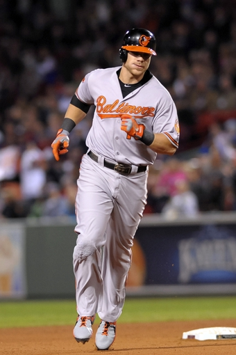 Sep 17, 2013; Boston, MA, USA; Baltimore Orioles first baseman Chris Davis (19) rounds the bases after hitting a home run during the sixth inning against the Boston Red Sox at Fenway Park. Mandatory Credit: Bob DeChiara-USA TODAY Sports