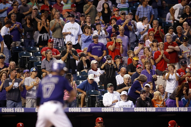 Sep 17, 2013; Denver, CO, USA; Colorado Rockies first baseman Todd Helton (17) gets a standing ovation while making his first appearance at the plate during the first inning against the St. Louis Cardinals at Coors Field. Mandatory Credit: Chris Humphreys-USA TODAY Sports