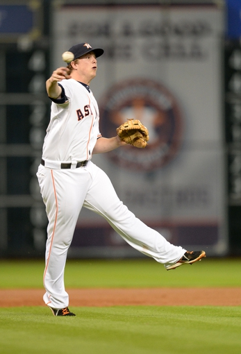 Sep 17, 2013; Houston, TX, USA; Houston Astros third baseman Matt Dominguez (30) throws out a runner against the Cincinnati Reds during the fourth inning at Minute Maid Park. Mandatory Credit: Thomas Campbell-USA TODAY Sports