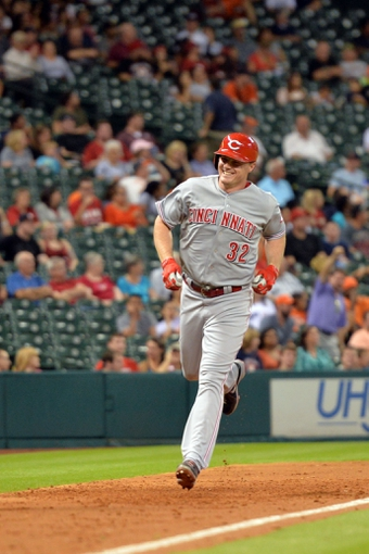Sep 17, 2013; Houston, TX, USA; Cincinnati Reds right fielder Jay Bruce (32) runs home after hitting a grand slam against the Houston Astros  during the fourth inning at Minute Maid Park. Mandatory Credit: Thomas Campbell-USA TODAY Sports