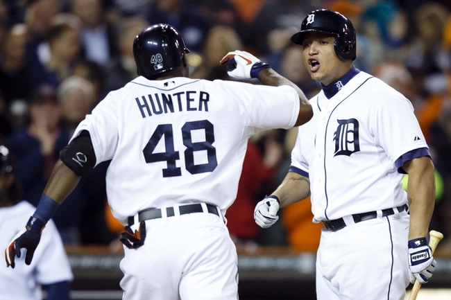Sep 17, 2013; Detroit, MI, USA; Detroit Tigers right fielder Torii Hunter (48) receive congratulation from third baseman Miguel Cabrera (24) after hitting a sacrifice fly to score shortstop Jose Iglesias (not pictured) in the seventh inning against the Seattle Mariners at Comerica Park. Mandatory Credit: Rick Osentoski-USA TODAY Sports