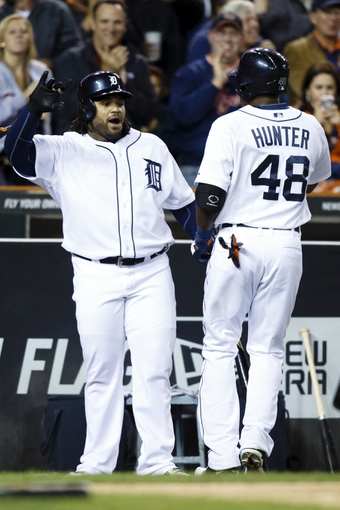 Sep 17, 2013; Detroit, MI, USA; Detroit Tigers right fielder Torii Hunter (48) receive congratulation from third baseman first baseman Prince Fielder (28) after hitting a sacrifice fly to score shortstop Jose Iglesias (not pictured) in the seventh inning against the Seattle Mariners at Comerica Park. Mandatory Credit: Rick Osentoski-USA TODAY Sports