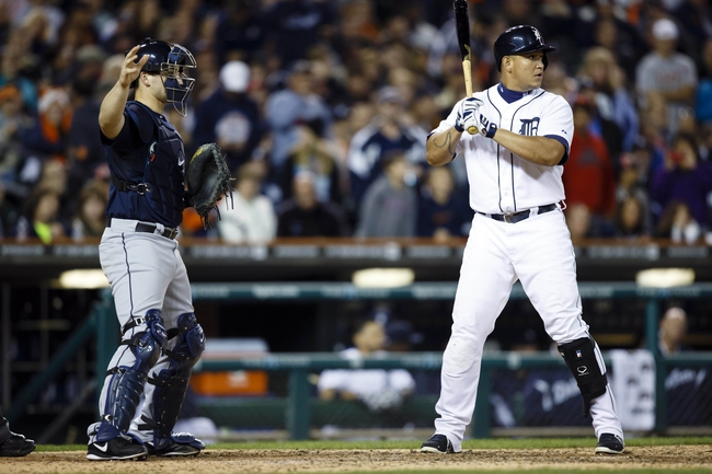 Sep 17, 2013; Detroit, MI, USA; Seattle Mariners catcher Mike Zunino (3) gives the single to intentionally walk Detroit Tigers third baseman Miguel Cabrera (24) in the seventh inning at Comerica Park. Mandatory Credit: Rick Osentoski-USA TODAY Sports