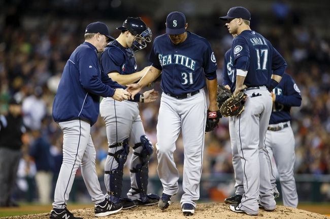 Sep 17, 2013; Detroit, MI, USA; Seattle Mariners manager Eric Wedge (22) takes the ball to relieve relief pitcher Yoervis Medina (31) in the seventh inning against the Detroit Tigers at Comerica Park. Mandatory Credit: Rick Osentoski-USA TODAY Sports