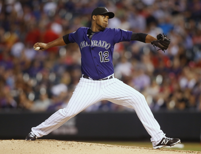 Sep 17, 2013; Denver, CO, USA; Colorado Rockies pitcher Juan Nicasio (12) delivers a pitch during the second inning against the St. Louis Cardinals at Coors Field. Mandatory Credit: Chris Humphreys-USA TODAY Sports
