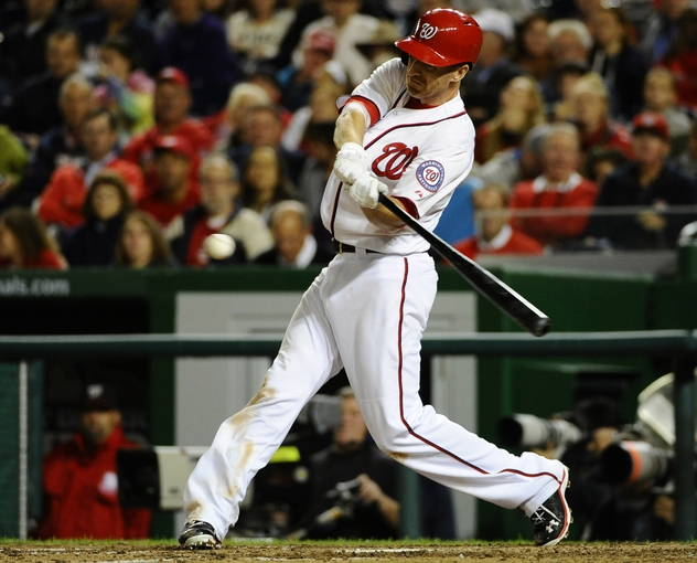 Sep 17, 2013; Washington, DC, USA; Washington Nationals first baseman Adam LaRoche (25) hits an RBI single during the eighth inning against the Atlanta Braves at Nationals Park. The Nationals won 4-0. Mandatory Credit: Brad Mills-USA TODAY Sports