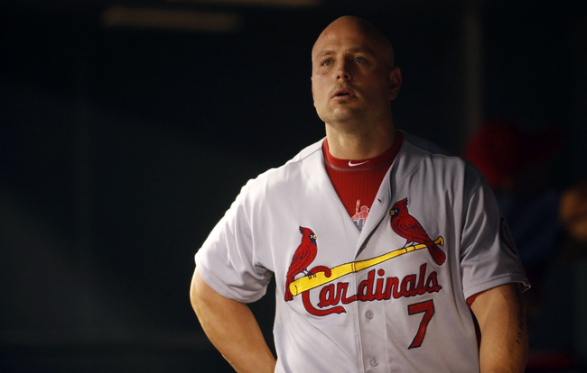 Sep 17, 2013; Denver, CO, USA; St. Louis Cardinals left fielder Matt Holliday (7) in the dugout during the second inning against the Colorado Rockies at Coors Field. Mandatory Credit: Chris Humphreys-USA TODAY Sports