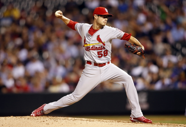 Sep 17, 2013; Denver, CO, USA; St. Louis Cardinals pitcher Joe Kelly (58) delivers a pitch during the second inning against the Colorado Rockies at Coors Field. Mandatory Credit: Chris Humphreys-USA TODAY Sports