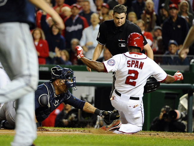 Sep 17, 2013; Washington, DC, USA; Washington Nationals center fielder Denard Span (2) is tagged out at home by Atlanta Braves catcher Gerald Laird (11) during the third inning at Nationals Park. The Nationals won 4 - 0. Mandatory Credit: Brad Mills-USA TODAY Sports