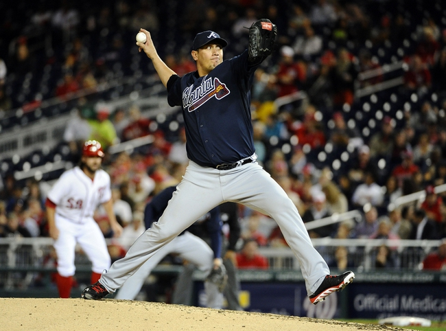 Sep 17, 2013; Washington, DC, USA; Atlanta Braves starting pitcher Freddy Garcia (50) throws during the third inning against the Washington Nationals at Nationals Park. Mandatory Credit: Brad Mills-USA TODAY Sports