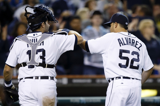 Sep 17, 2013; Detroit, MI, USA; Detroit Tigers catcher Alex Avila (13) and starting pitcher Jose Alvarez (52) celebrate after an inning ending double play in the eighth inning against the Seattle Mariners at Comerica Park. Mandatory Credit: Rick Osentoski-USA TODAY Sports