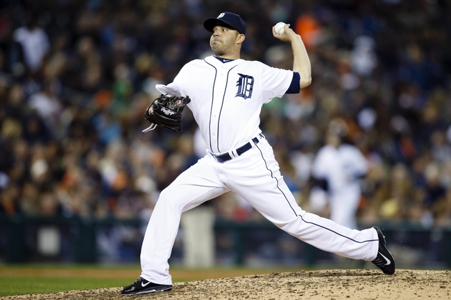 Sep 17, 2013; Detroit, MI, USA; Detroit Tigers starting pitcher Jose Alvarez (52) pitches in the eighth inning against the Seattle Mariners at Comerica Park. Mandatory Credit: Rick Osentoski-USA TODAY Sports