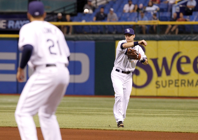 Sep 17, 2013; St. Petersburg, FL, USA; Tampa Bay Rays second baseman Ben Zobrist (right) throws the ball to first baseman James Loney (21) for an out during the fourth inning against the Texas Rangers at Tropicana Field. Texas Rangers defeated the Tampa Bay Rays 7-1. Mandatory Credit: Kim Klement-USA TODAY Sports