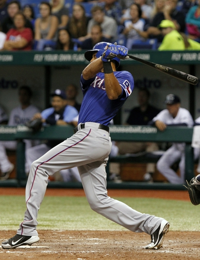 Sep 17, 2013; St. Petersburg, FL, USA; Texas Rangers right fielder Alex Rios (51) singles during the fifth inning against the Tampa Bay Rays at Tropicana Field. Texas Rangers defeated the Tampa Bay Rays 7-1. Mandatory Credit: Kim Klement-USA TODAY Sports