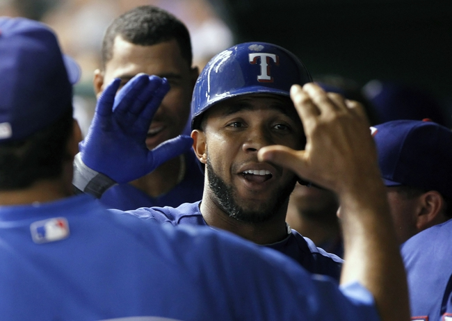 Sep 17, 2013; St. Petersburg, FL, USA; Texas Rangers shortstop Elvis Andrus (1) is congratulated by teammates after he hit a sacrifice RBI during the fifth inning against the Tampa Bay Rays at Tropicana Field. Texas Rangers defeated the Tampa Bay Rays 7-1. Mandatory Credit: Kim Klement-USA TODAY Sports