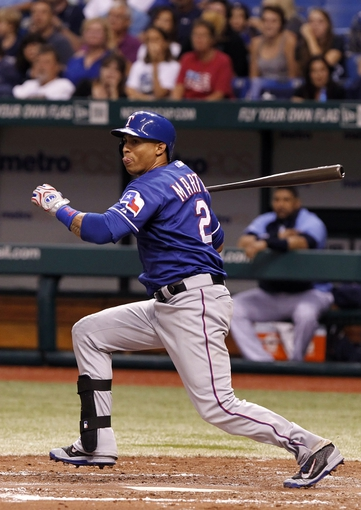 Sep 17, 2013; St. Petersburg, FL, USA;Texas Rangers center fielder Leonys Martin (2) doubles during the fifth inning against the Tampa Bay Rays at Tropicana Field. Texas Rangers defeated the Tampa Bay Rays 7-1. Mandatory Credit: Kim Klement-USA TODAY Sports