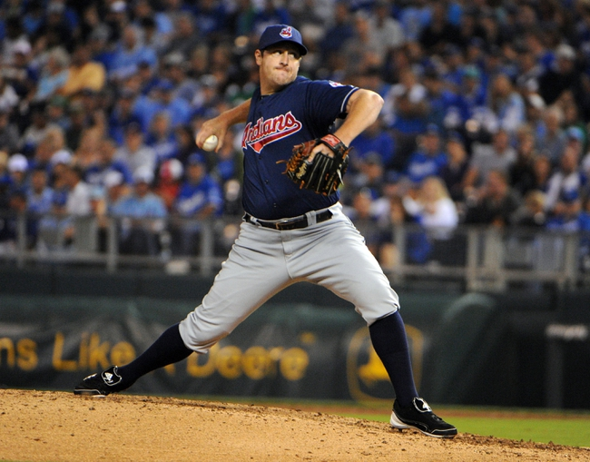 Sep 17, 2013; Kansas City, MO, USA; Cleveland Indians relief pitcher Bryan Shaw (27) delivers a pitch against the Kansas City Royals in the sixth inning at Kauffman Stadium. Mandatory Credit: John Rieger-USA TODAY Sports