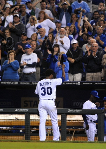 Sep 17, 2013; Kansas City, MO, USA; Kansas City Royals starting pitcher Yordano Ventura (30) tips his hat to the crowd as he leaves the field in the sixth inning against the Cleveland Indians at Kauffman Stadium. Mandatory Credit: John Rieger-USA TODAY Sports