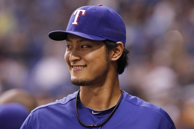 Sep 17, 2013; St. Petersburg, FL, USA; Texas Rangers pitcher Yu Darvish (11) stands in the dugout against the Tampa Bay Rays at Tropicana Field. The Rangers won 7-1. Mandatory Credit: Kim Klement-USA TODAY Sports