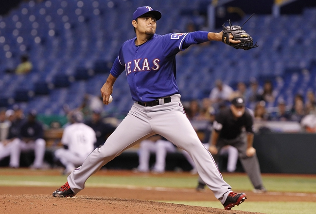 Sep 17, 2013; St. Petersburg, FL, USA; Texas Rangers relief pitcher Joakim Soria (28) throws the ball during the sixth inning against the Tampa Bay Rays at Tropicana Field. The Rangers won 7-1. Mandatory Credit: Kim Klement-USA TODAY Sports