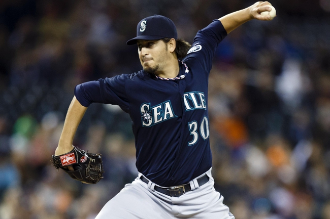 Sep 17, 2013; Detroit, MI, USA; Seattle Mariners relief pitcher Bobby LaFromboise (30) pitches in the eighth inning against the Detroit Tigers at Comerica Park. Mandatory Credit: Rick Osentoski-USA TODAY Sports