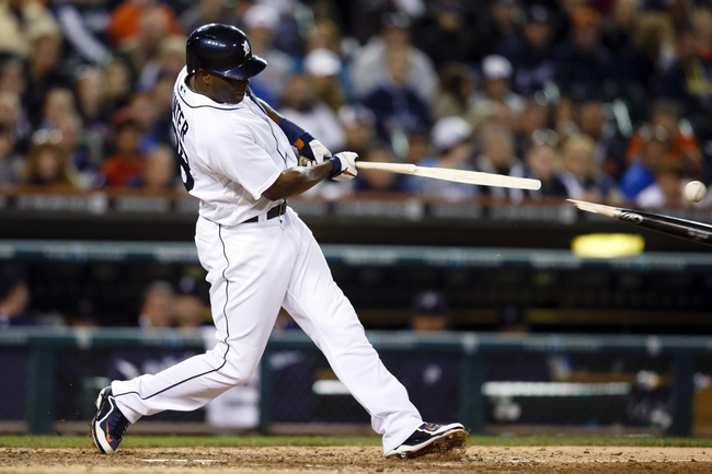 Sep 17, 2013; Detroit, MI, USA; Detroit Tigers right fielder Torii Hunter (48) breaks his back hitting into a fielders choice play in the eighth inning against the Seattle Mariners at Comerica Park. Mandatory Credit: Rick Osentoski-USA TODAY Sports