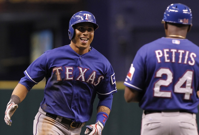 Sep 17, 2013; St. Petersburg, FL, USA; Texas Rangers center fielder Leonys Martin (2) celebrates with third base coach Gary Pettis (24) after hitting a solo home run during the ninth inning against the Tampa Bay Rays at Tropicana Field. The Rangers won 7-1. Mandatory Credit: Kim Klement-USA TODAY Sports
