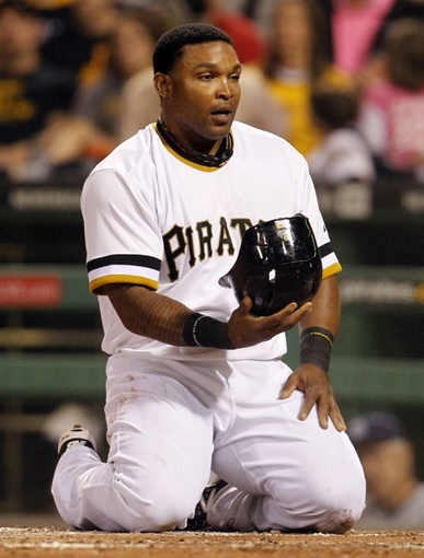 Sep 17, 2013; Pittsburgh, PA, USA; Pittsburgh Pirates right fielder Marlon Byrd (2) reacts after being thrown out at home plate by the San Diego Padres during the third inning at PNC Park. The San Diego Padres won 5-2. Mandatory Credit: Charles LeClaire-USA TODAY Sports