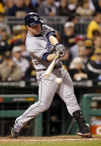 Sep 17, 2013; Pittsburgh, PA, USA; San Diego Padres second baseman Jedd Gyorko (9) hits an infield single against the Pittsburgh Pirates during the seventh inning at PNC Park. The San Diego Padres won 5-2. Mandatory Credit: Charles LeClaire-USA TODAY Sports