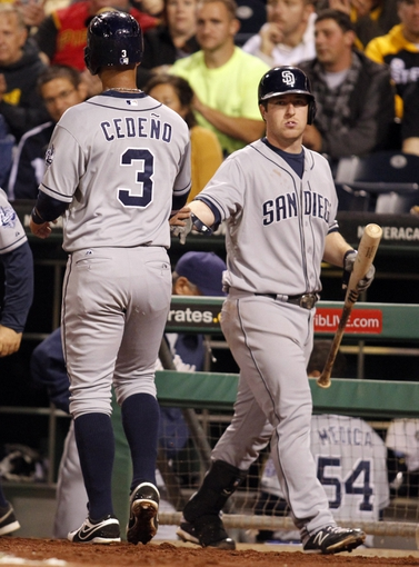 Sep 17, 2013; Pittsburgh, PA, USA; San Diego Padres shortstop Ronny Cedeno (3) is greeted after scoring a run by second baseman Jedd Gyorko (9) against the Pittsburgh Pirates during the fourth inning at PNC Park. The San Diego Padres won 5-2. Mandatory Credit: Charles LeClaire-USA TODAY Sports