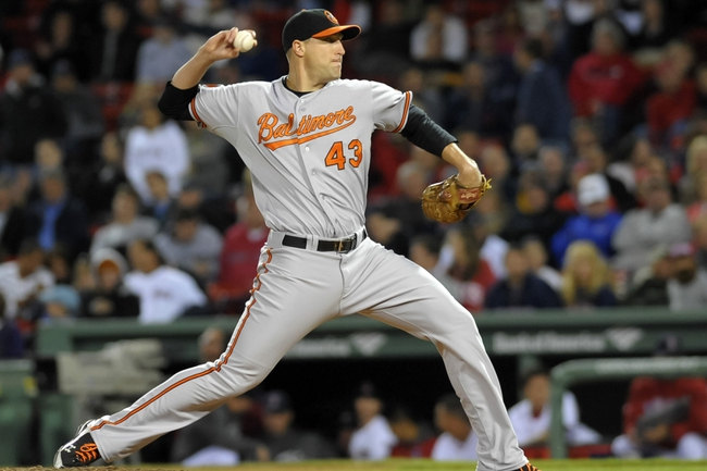 Sep 17, 2013; Boston, MA, USA; Baltimore Orioles relief pitcher Jim Johnson (43) pitches during the ninth inning against the Boston Red Sox at Fenway Park. Mandatory Credit: Bob DeChiara-USA TODAY Sports