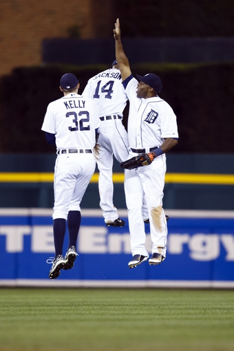Sep 17, 2013; Detroit, MI, USA; Detroit Tigers left fielder Don Kelly (32), center fielder Austin Jackson (14) and right fielder Torii Hunter (48) celebrate after the game against the Seattle Mariners at Comerica Park. Detroit won 6-2. Mandatory Credit: Rick Osentoski-USA TODAY Sports