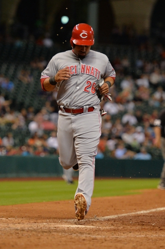 Sep 17, 2013; Houston, TX, USA; Cincinnati Reds left fielder Xavier Paul (26) scores a run against the Houston Astros during the seventh inning at Minute Maid Park. The Reds won 10-0. Mandatory Credit: Thomas Campbell-USA TODAY Sports
