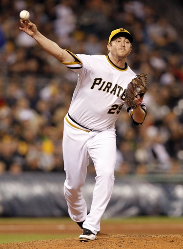 Sep 17, 2013; Pittsburgh, PA, USA; Pittsburgh Pirates relief pitcher Bryan Morris (29) throws to first on a pick-off attempt against the San Diego Padres during the seventh inning at PNC Park. The San Diego Padres won 5-2. Mandatory Credit: Charles LeClaire-USA TODAY Sports