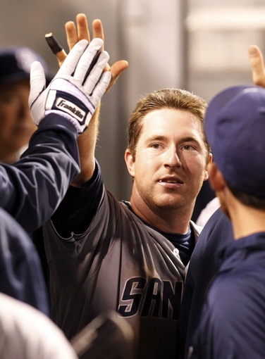 Sep 17, 2013; Pittsburgh, PA, USA; San Diego Padres second baseman Jedd Gyorko (9) is greeted in the dugout after scoring a run against the Pittsburgh Pirates during the seventh inning at PNC Park. The San Diego Padres won 5-2. Mandatory Credit: Charles LeClaire-USA TODAY Sports