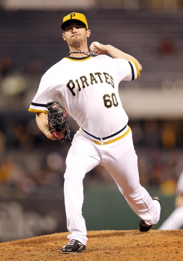 Sep 17, 2013; Pittsburgh, PA, USA; Pittsburgh Pirates starting pitcher Kris Johnson (60) pitches against the San Diego Padres during the ninth inning at PNC Park. The San Diego Padres won 5-2. Mandatory Credit: Charles LeClaire-USA TODAY Sports