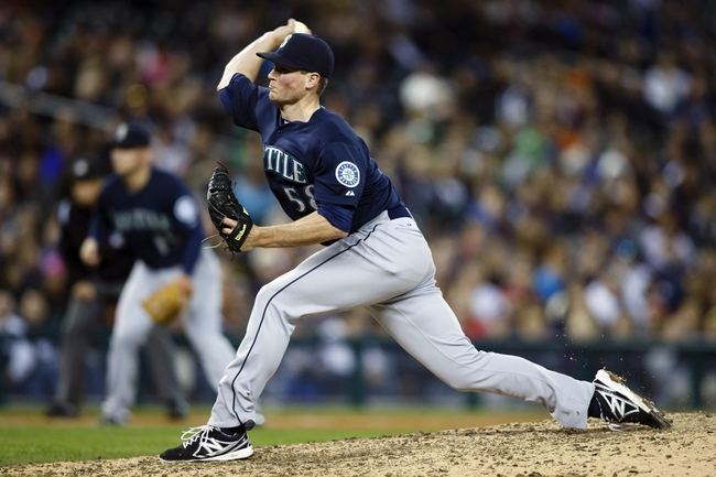 Sep 17, 2013; Detroit, MI, USA; Seattle Mariners relief pitcher Carter Capps (58) pitches in the eighth inning against the Detroit Tigers at Comerica Park. Detroit won 6-2. Mandatory Credit: Rick Osentoski-USA TODAY Sports