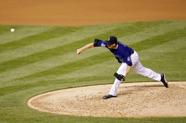 Sep 17, 2013; Denver, CO, USA; Colorado Rockies pitcher Rob Scahill (62) delivers a pitch during the fourth inning against the St. Louis Cardinals at Coors Field. Mandatory Credit: Chris Humphreys-USA TODAY Sports