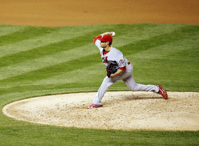 Sep 17, 2013; Denver, CO, USA; St. Louis Cardinals pitcher Joe Kelly (58) delivers a pitch during the fourth inning against the Colorado Rockies at Coors Field. Mandatory Credit: Chris Humphreys-USA TODAY Sports