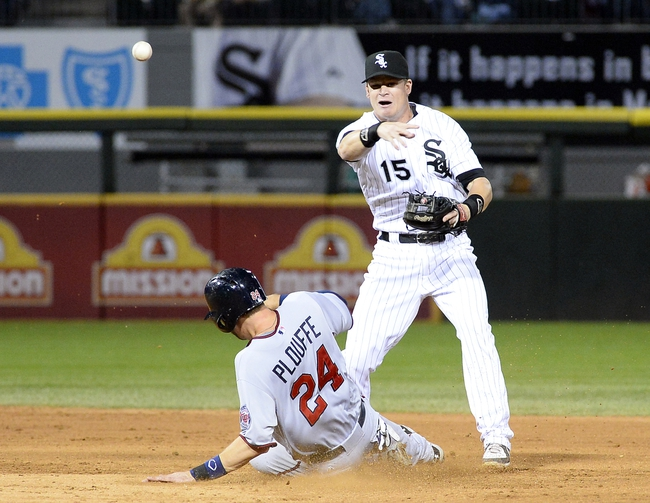 Sep 17, 2013; Chicago, IL, USA; Chicago White Sox second baseman Gordon Beckham (15) attempts to make a double play against Minnesota Twins third baseman Trevor Plouffe (24) during the seven
